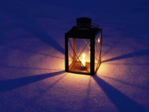 Lit Lantern in Snow