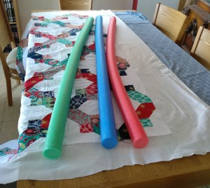 Basting a Quilt With Pool Noodles