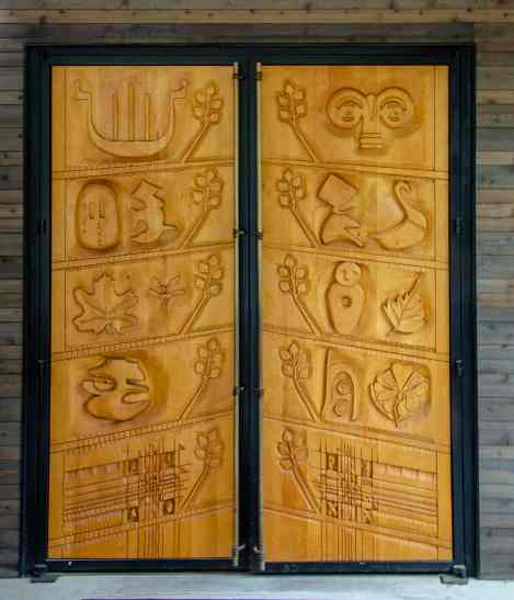 Yellow cedar front door of the Scandinavian Heritage Foundation in Portland carved by Leroy Setziol and Monica Setziol-Phillips