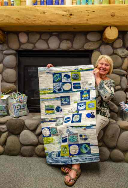 Jean Wells displays one of her quilts