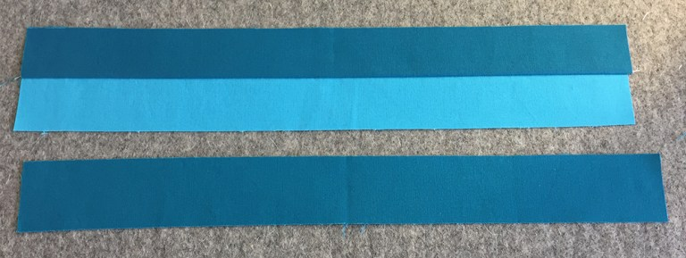 Three strips, two sewn together