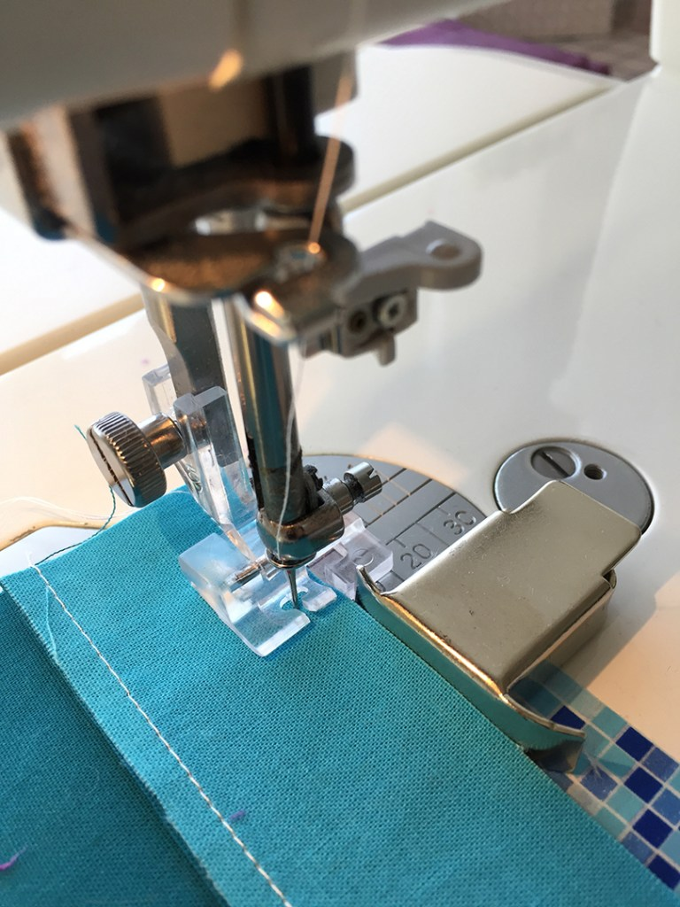 Sewing the third strip to a pair