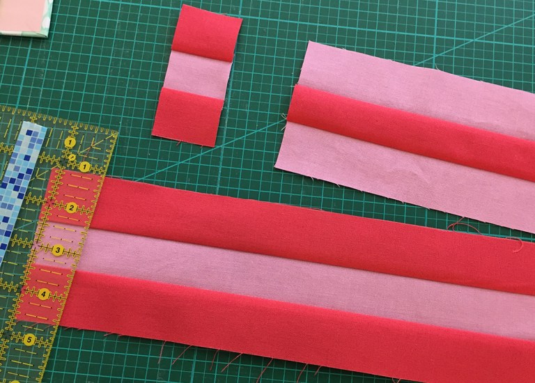 Pink strips being subcut into units