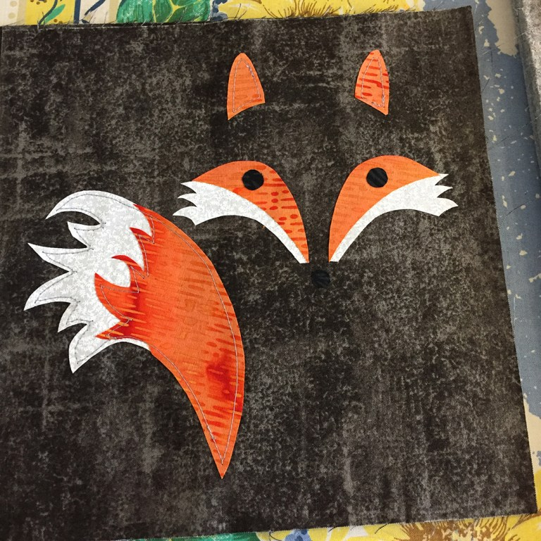 Applique fox on gray background