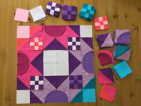 Pieced units laid out for a quilt block