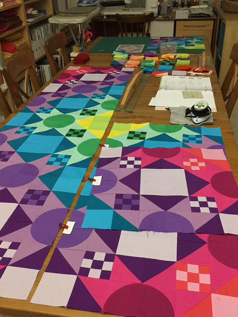 Rows of pieced blocks for a quilt