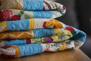 close-up of a quilt folded in a tall stack