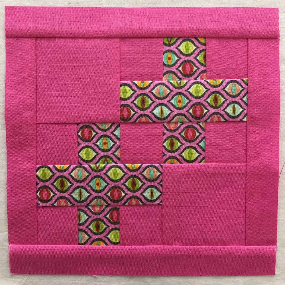 quilt block in shades of pink