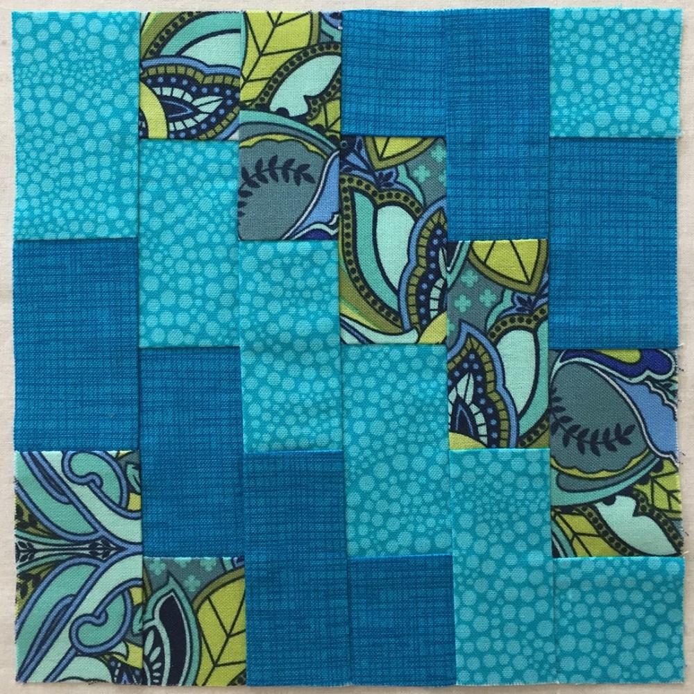 a quilt block in aqua