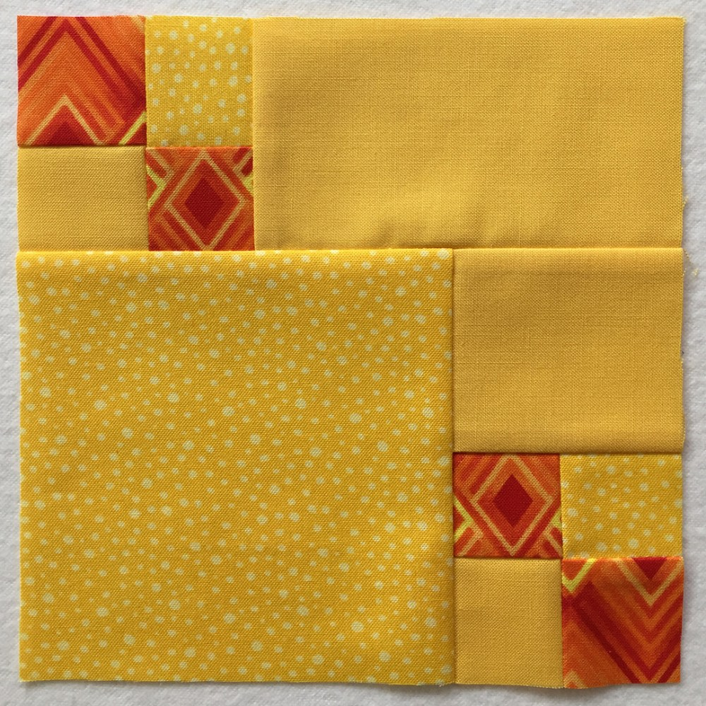 quilt block in yellow and orange