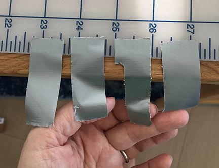 Four short strips of duct tape