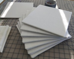 A stack of 7 finished mini design boards