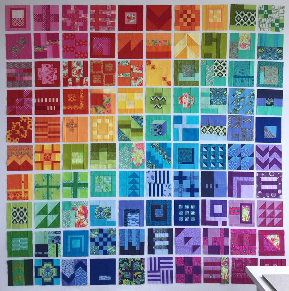blocks arranged in a rainbow on my design wall