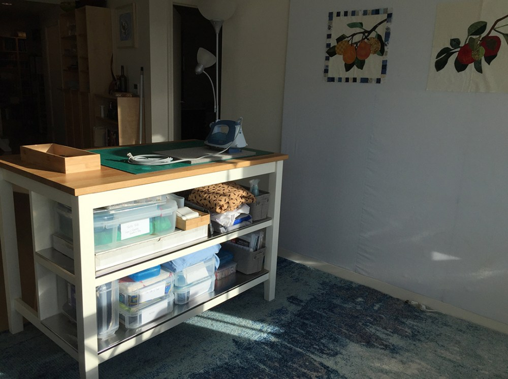 a butcher block table with shelves