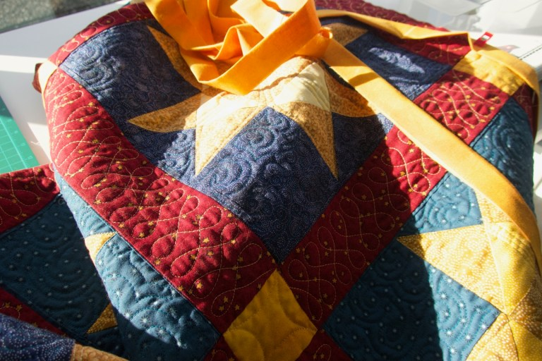 Quilt and binding strip in the sunlight