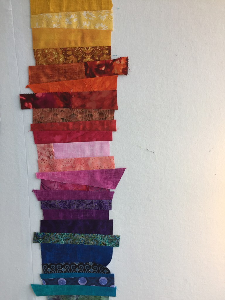 strips of fabric in a rainbow with uneven edges