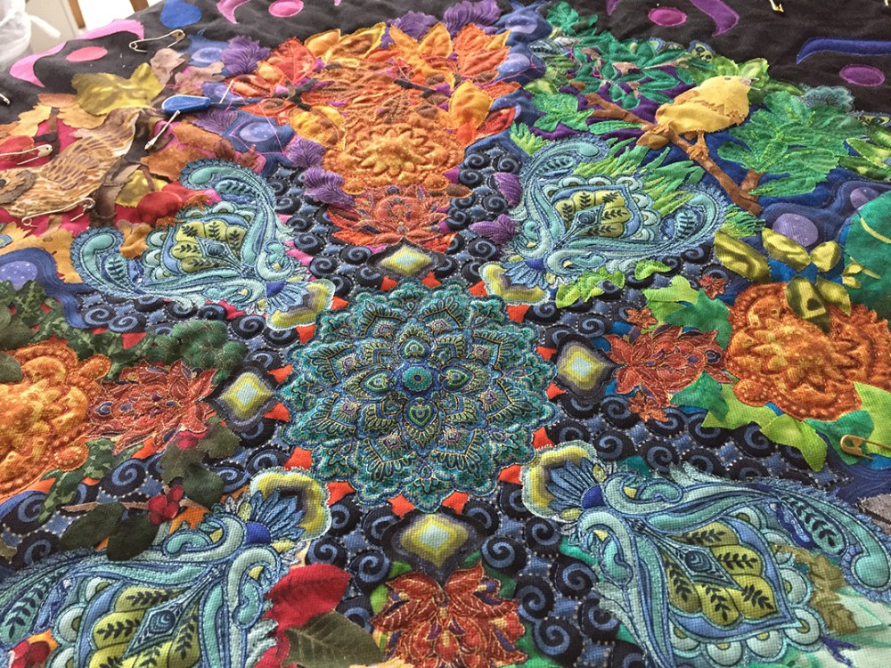 close up of the mandala quilt top center showing some parts already quilted