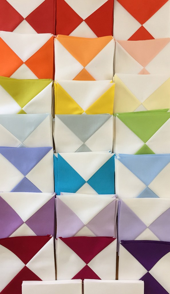 picture of colorful quilt blocks ready to sew into a quilt top
