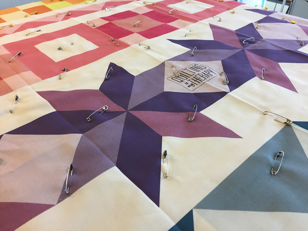 a quilt that has been sandwiched and pin basted