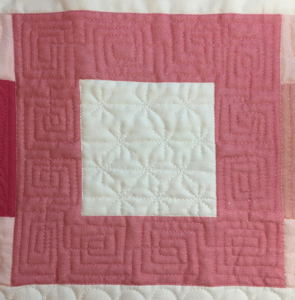 a quilted square in a square block