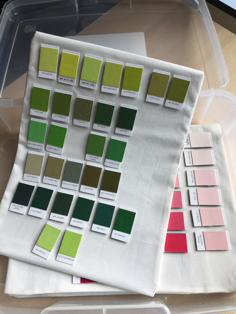 several fabric-covered flexible magnetic sheets with colored swatch magnets on them