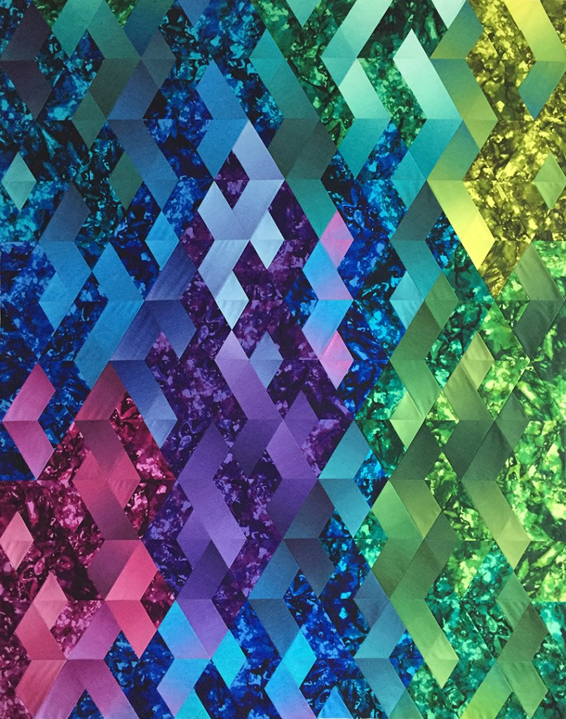 Colorful quilt made of diamond shapes that look like dragon scales