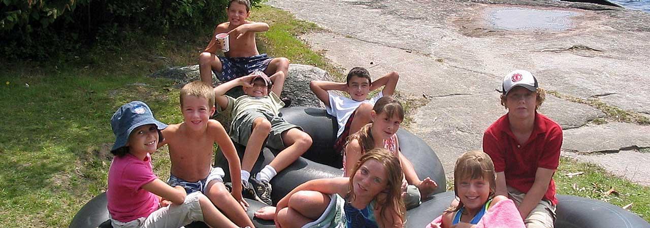 inner-tube-kids-at-lake