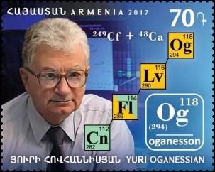 El elemento 118 fue nombrado en honor a Yuri Oganessian, un pionero en el descubrimiento de elementos sintéticos, con el nombre de oganesón (Og). Oganessian y la cadena de decadencia de oganeson-294 fueron representados en un sello de Armenia emitido el 28 de diciembre de 2017.