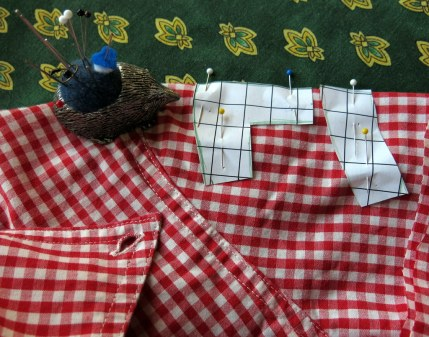 Find some gingham - I cut up a (worn out) shirt! The pattern pieces are made on squared paper where the squares are half an inch (1.2 cm) a side. Place pieces on a fold and cut two of each. Sew with 1/8 inch seam.