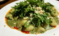 gnocchi with coriander and macadamia pesto,chilli oil, beans and rocket