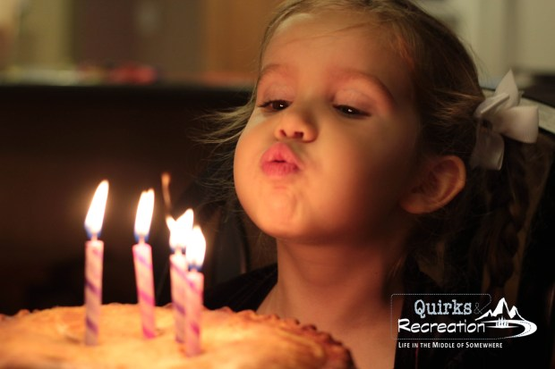 Daughter blowing out four birthday candles