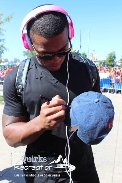 Denver Bronco Demaryius Thomas signing an autograph