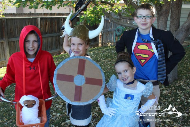 Siblings dressed as Clark Kent, Cinderella, Elliott from ET and a Viking for Halloween costumes
