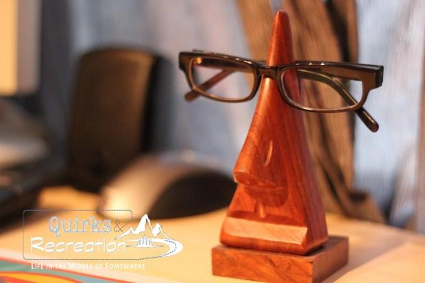 black plastic frame glasses resting on a stand