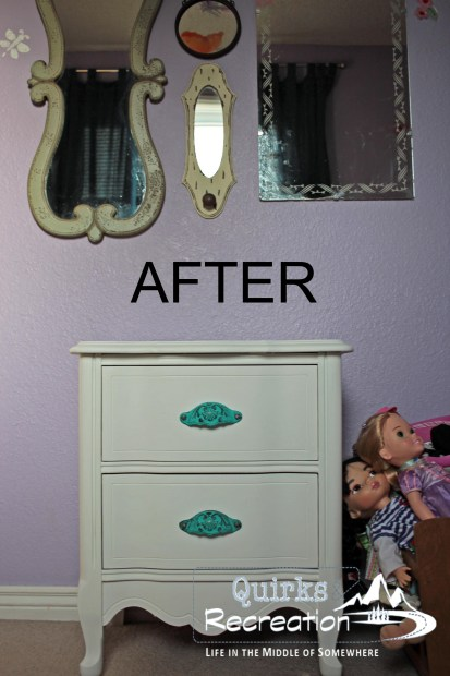 white nightstand with blue handles against purple wall