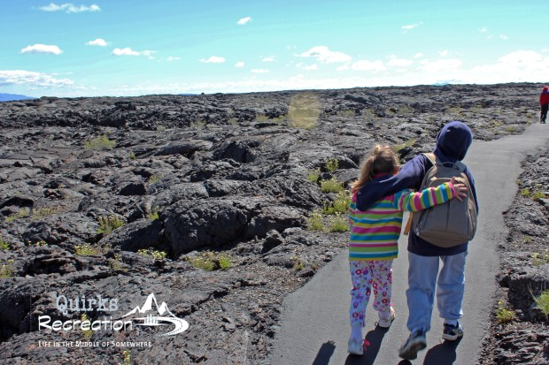 two children hiking in Craters of the Moon