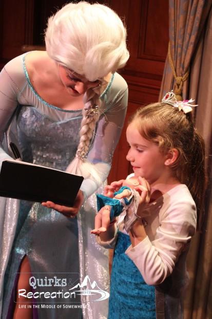 Queen Elsa signing autograph book Magic Kingdom Disney World