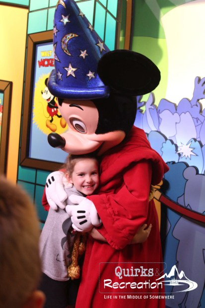 Little girl hugging Mickey Mouse at Walt Disney World