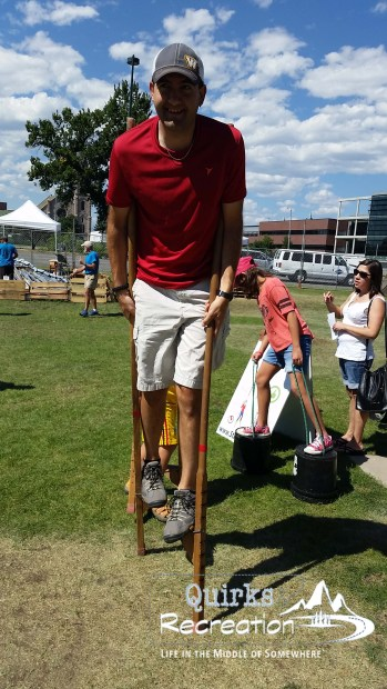 man walking on stilts