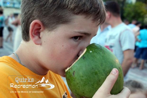 boy drinking from coconut Key West