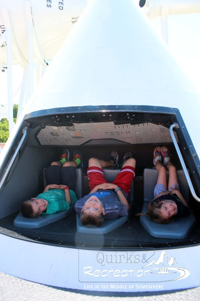 children inside rocket capsule at the rocket garden Kennedy Space Center