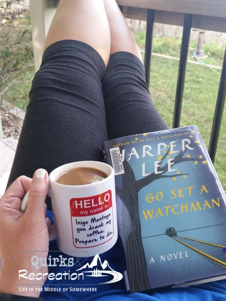 woman reading Go Set a Watchman and drinking coffee