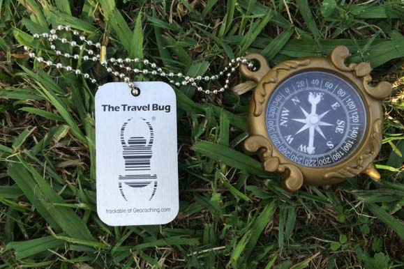 Compass Bug geocaching travel bug