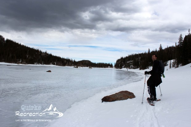 Man snowshoeing at The Loch in Rocky Mountain National Park