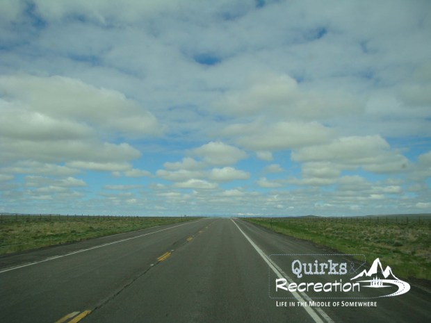open road with a cloudy blue sky