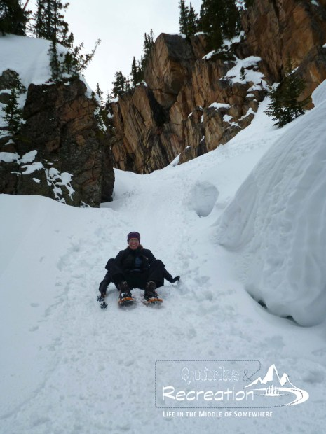 Woman sliding down a mountain gorge in Rocky Mountain National Park