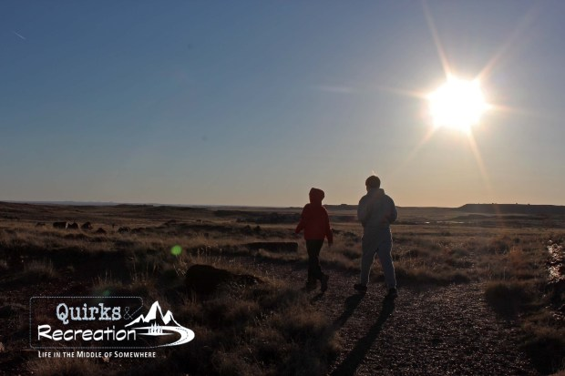 Hikers in Petrified Forest National Park near sunset