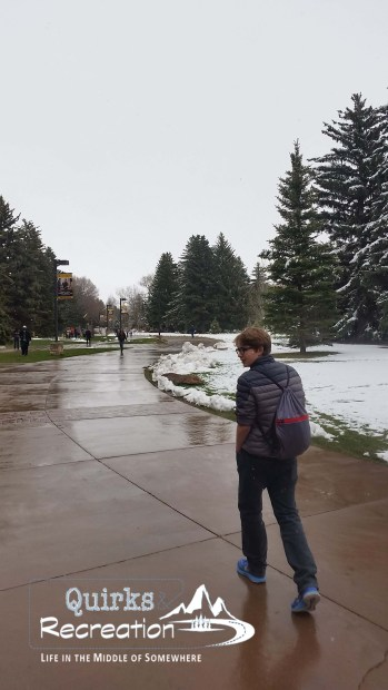 boy walking around University of Wyoming campus