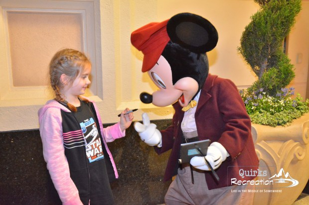 Mickey signing autographs