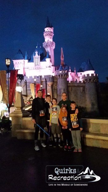 family in front of castle during run disney 5k